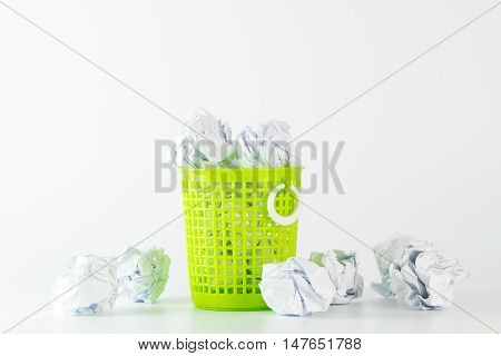 Trash Bin And Crumpled Paper Balls