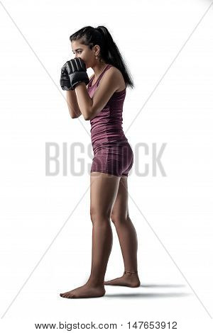female mma fighter in blocking stance isolated on white background