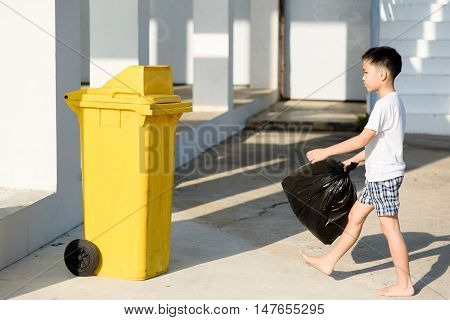 Boy Carry Garbage
