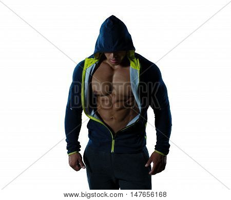 Muscle athletic man in a jacket with a hood, abdominal on isolated white background