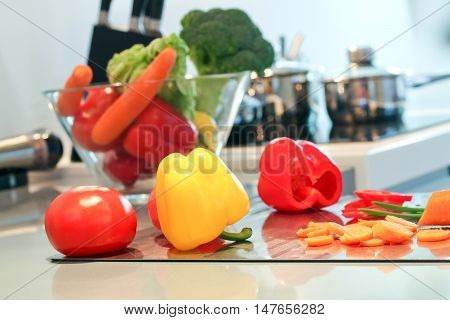 Fresh vegetables(paprika; tomato) on the cutting board. Concept of cooking.