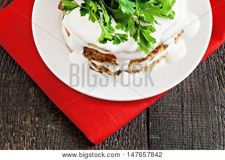 Zucchini Cake Watered Sauce On A Red Napkin