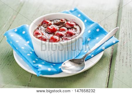 Chocolate And Cherry Mousse On Blue Napkin