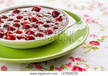 Chocolate And Cherry Mousse In A Green Plate