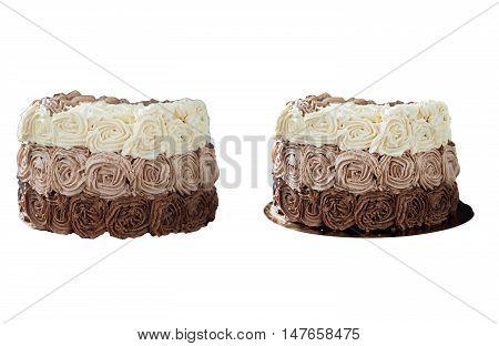 Birthday cake decorated with three chocolate cream roses.