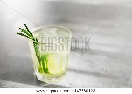 Cold fresh cocktail with lime on light background