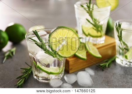 Cold fresh cocktails with lime on table