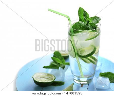 Cold fresh cocktail with lime on board on light background