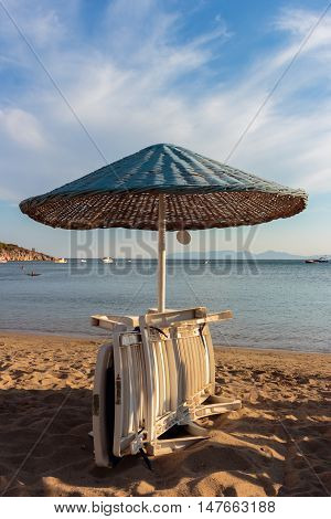 Loungers and beach umbrellas. A beautiful view of the beach resort.