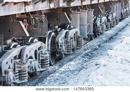 Wheels and wheel truck with three axles, heavy rail freight wagon.