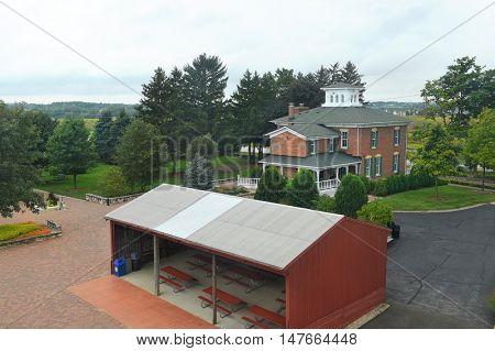 GENEVA, ILLINOIS - SEPTEMBER 9, 2016: History Gallery, Gift Shop and 3 sided Barn at the Peck Farm Park Interpretative Center, a 385 acre natural retreat.