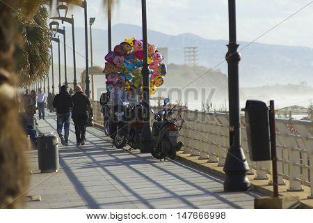 Beirut, Lebanon - January 09, 2016:  Balloons seller and pedestrians on Beirut seaside near Ramlet el-Baida beach,street view, Lebanon