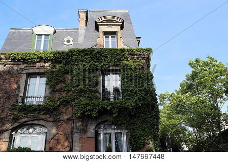 PARIS, FRANCE - MAY 12, 2015: This is one of old houses in Montmartre which gives the atmosphere of the old quarter of Paris.