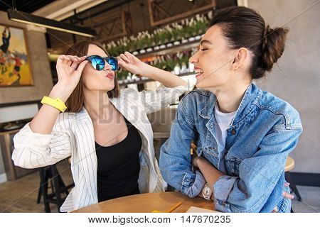 look how cool I am, girl wearing trendy sunglasses