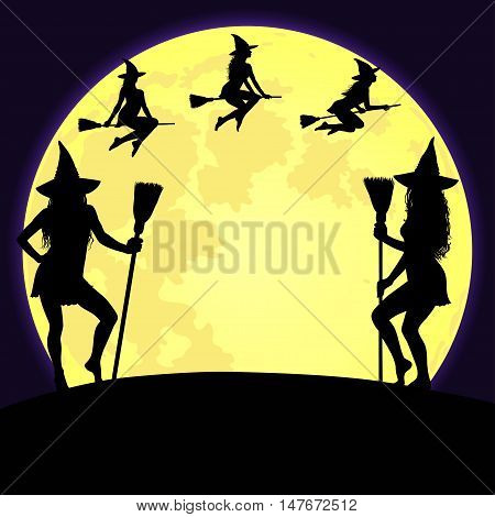 Halloween background with big shining yellow moon and silhouettes of witches standing with broomstick and flying in the sky.