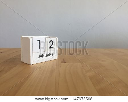 January 12Th.january 12 White Wooden Calendar On Wood Background.copyspace For Text.