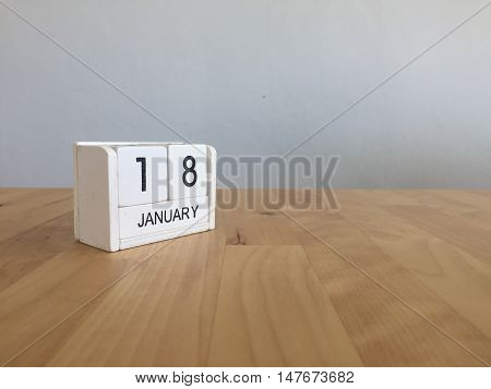 January 18Th.january 18  White Wooden Calendar On Wood Background.copyspace For Text.