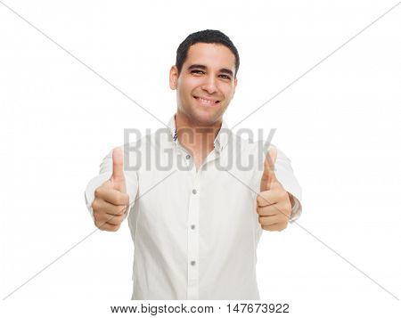 happy smiling young man with his thumbs up isolated against white studio background