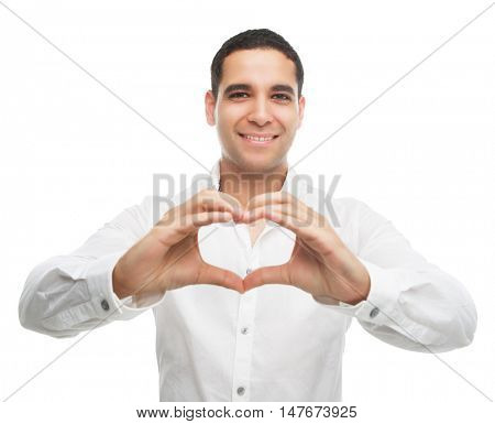happy smiling young man showing a sign of a heart with his fingers, isolated against white studio background