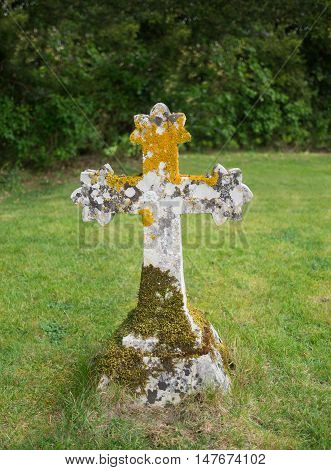 Ancient stone Celtic style cross with moss and lichen