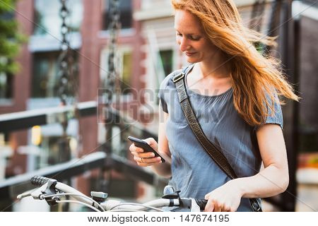 Casual Woman With A Phone In An Old Town