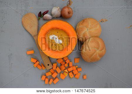 Cream of pumpkin soup served in half a pumpkin