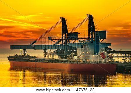 Big ship under loading coal in Port of Gdansk Poland.
