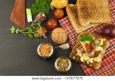 Toast with scrambled eggs. Quick and nutritious breakfast. Eggs with vegetables and bacon. Dietary supplements for athletes. Protein meal.