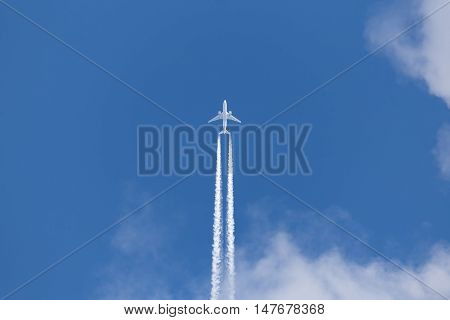 jet leaves the contrail in blue sky