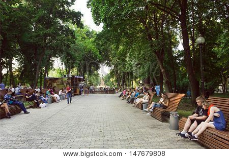 KYIV, UKRAINE - SEP 10, 2016: People relaxing on benches of popular Shevchenko park on September 10, 2016. Kiev is the 8th most populous city in Europe.