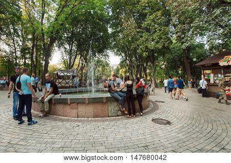 KYIV, UKRAINE - SEP 10, 2016: People relaxing near fountain in popular Shevchenko park on September 10, 2016. Kiev is the 8th most populous city in Europe.