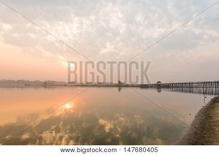 U bein bridge with sunriseThe longest wooden bridge in MandalayMyanmar.