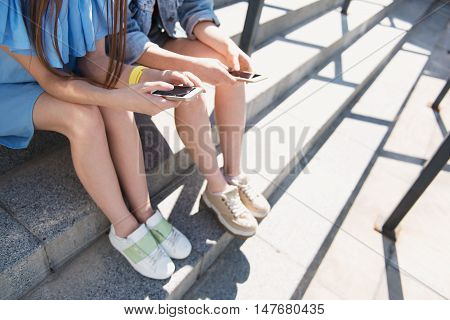 close up of a girls surfing the web on their phones