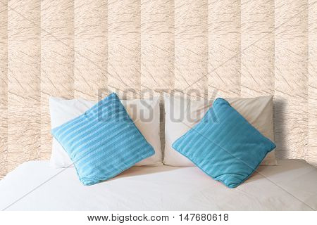 white pillow and blue pillow on bed and with blanket in vintage bedroom