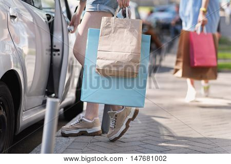 waist down view of a woman with bags