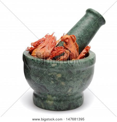 Organic Flower of Javitri or Mace (Myristica Fragrans) on marble pestle. Isolated on white background.