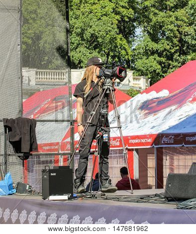 St. Petersburg, Russia - 12 August, Cameraman in equipment,12 August, 2016. Pop and rock musicians on Harley Davidson festival in St. Petersburg.