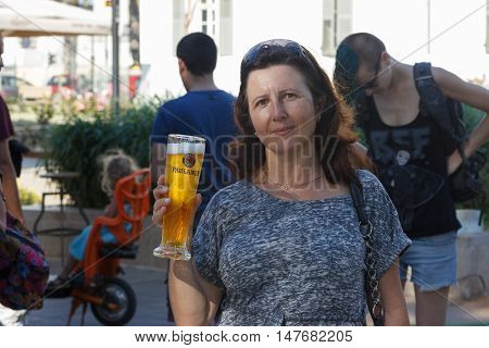 Beer Festival Visitor Poses With A Glass Of Beer