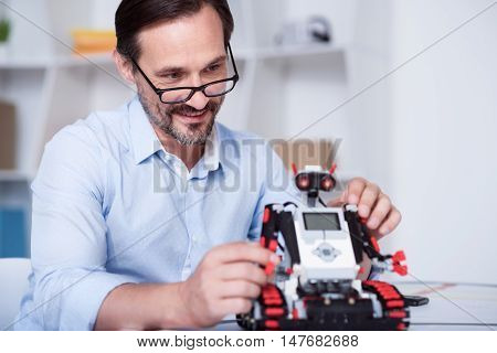 World of science. White man in glasses inventing technologies of future