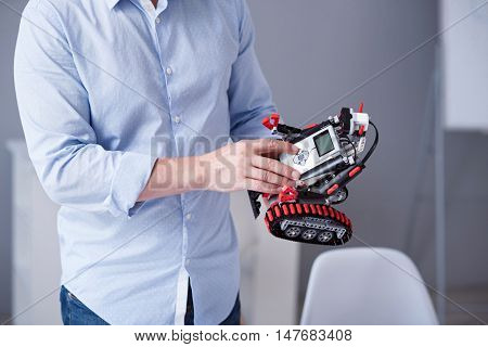 Technology of future. Little robot being tested by a male
