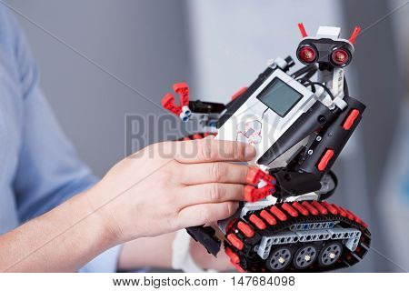 Cute creature. Small robot looking funny with its ocular