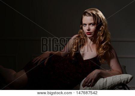 1940s glamour portrait lying on a couch
