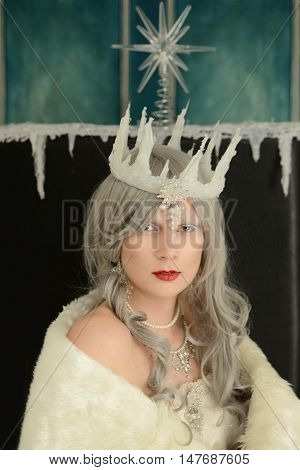 closeup portrait snow queen on throne wearing a crown