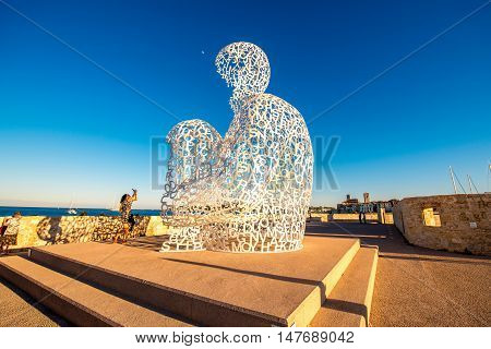 Antibes, France - June 14, 2016: Nomade, A Man of Letters Looking Out Over The Mediterranean in Antibes village. This sculpture is a creation by contemporary Catalan artist Jaume Plensa.