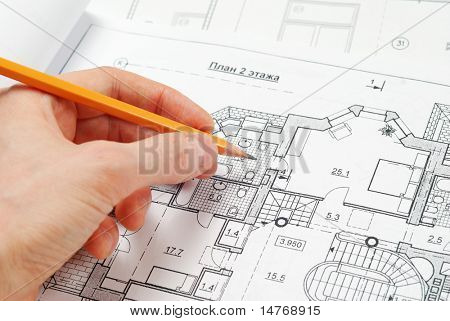 House plan blueprints, designer's hand