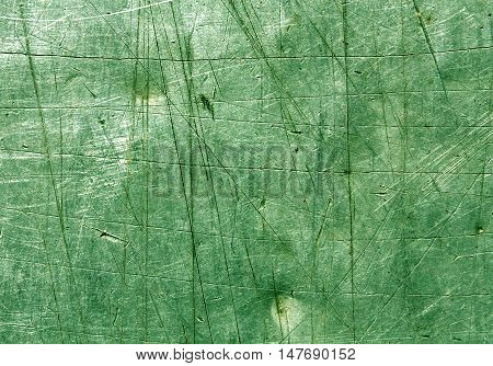 Green Scratched Metal Surface.