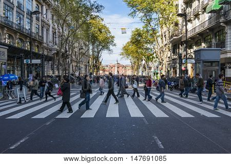 Buenos Aires Argentina - October 3 2013: People crossing a pedestrian crossing in the Avenida de Mayo in Buenos Aires Argentina
