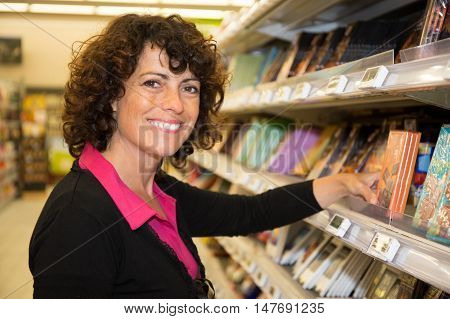 Smiling Woman Shopping For Diary Products At A Grocery Store/supermarket (color Toned Image)