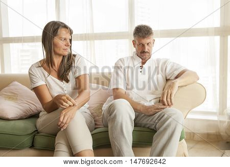 middle aged couple having an argument at home