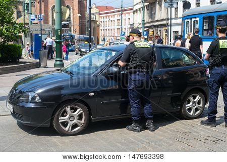 POLAND, KRAKOW - MAY 27, 2016: Polish guards of an order monitor in the historical part of Krakow.